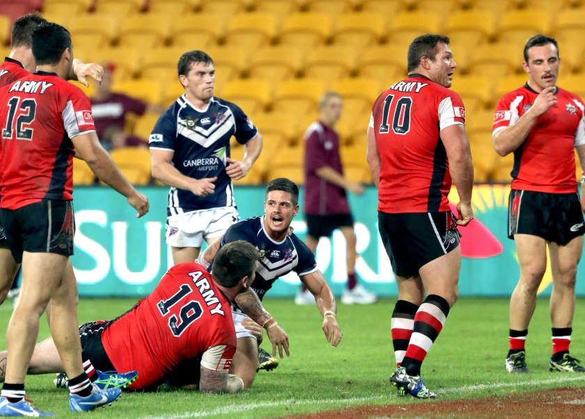 Aircraftman Joel Munro celebrates scoring Air Force's first and only try of the game. *** Local Caption *** Army and Air Force rugby league teams played a curtain raiser match to the first State of Origin at Suncorp Stadium, marking the 100th State of Origin match. (Australian Defence Image Libarary, Web. 2014).