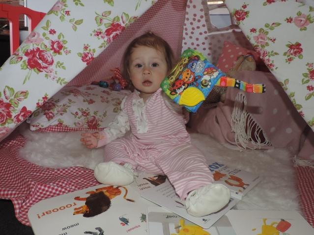 Larabella loves reading her books in her teepee.