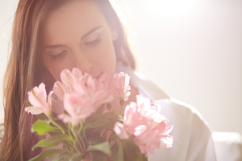 Writer holding pink flowers